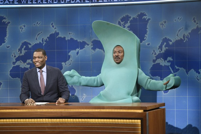 "SATURDAY NIGHT LIVE -- ""Eddie Murphy"" Episode 1777 -- Pictured: (l-r) Michael Che, and host Eddie Murphy as Gumby during Weekend Update on Saturday, December 21, 2019 -- (Photo by: Will Heath/NBC/NBCU Photo Bank via Getty Images)"