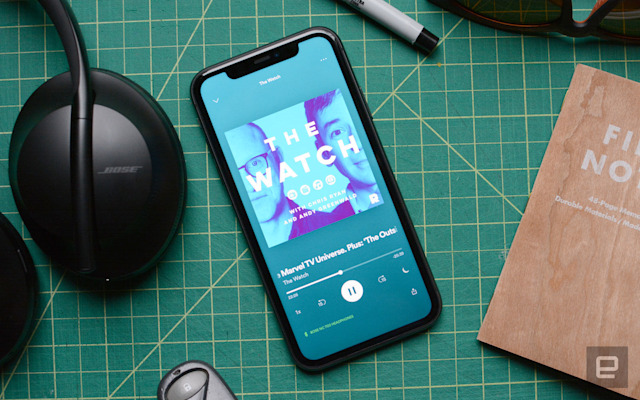 A pic showing a phone with a podcast queued up on Spotify.
