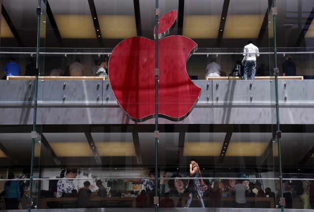 The Apple logo on display at the Sydney Apple Store is illuminated in red to mark World AIDS Day, in Sydney December 1, 2014. Apple stores across the world will display similar colored logos, with the Sydney store being the first. World AIDS Day is observed annually on December 1, which helps to raise awareness about AIDS and the spread of HIV.      REUTERS/David Gray      (AUSTRALIA - Tags: SOCIETY BUSINESS LOGO TPX IMAGES OF THE DAY)