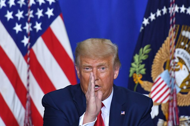 TOPSHOT - US President Donald Trump speaks to officials during a roundtable discussion on community safety, at Mary D. Bradford High School in in Kenosha, Wisconsin on September 1, 2020. - Trump in Kenosha says violent anti-police protests were 'domestic terror.' (Photo by MANDEL NGAN / AFP) (Photo by MANDEL NGAN/AFP via Getty Images)