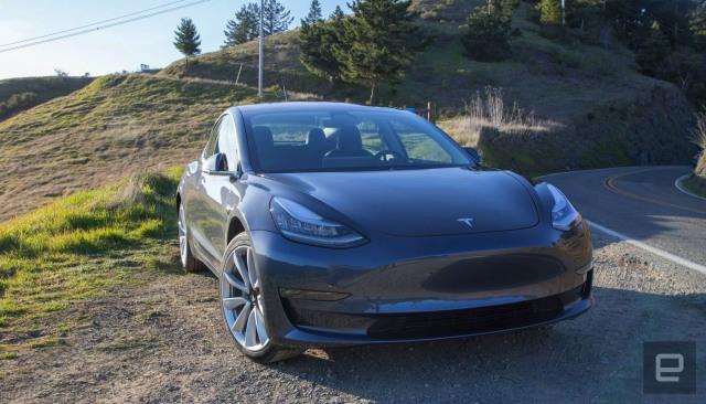 Tesla EV on the side of a road.