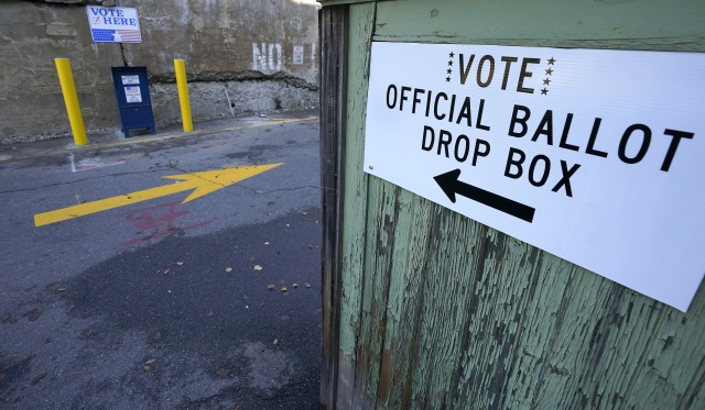 A ballot drop box is stationed outside Haverhill City Hall during early voting, Thursday, Oct. 22, 2020, in Haverhill, Mass. (AP Photo/Elise Amendola)