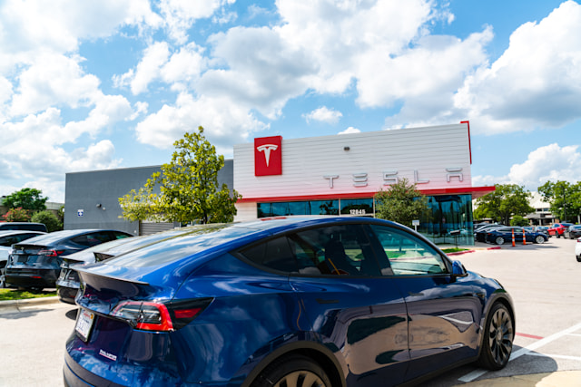 Austin, TX, USA - September 15, 2020: Tesla Motors in the growing pond springs location overflowing with Electric Tesla Vehicles with nice.blue Model Y parked in front