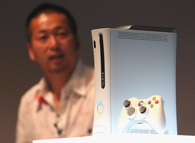 TOKYO - MAY 13: Microsoft's new Xbox360 game console is introduced during a press preview on May 13, 2005 in Tokyo, Japan. The machine is equipped with IBM's PowerPC on its CPU, 20GB HDD and 512MB RAM, and has a wireless controler. (Photo by Koichi Kamoshida/Getty Images)