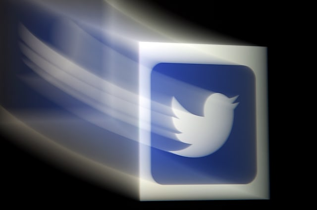 In this photo illustration, a Twitter logo is displayed on a mobile phone on August 10, 2020, in Arlington, Virginia. - Wall Street was mixed early August 10, 2020, with Nasdaq retreating further as investors digested President Donald Trump's efforts to take unilateral action in the absence of a deal with Congress on emergency pandemic spending. About an hour into the first trading session of the week, the tech-rich Nasdaq was down 0.4 percent to 10,963.75, while the Dow Jones Industrial Average gained 0.95 percent to 27,686.07 and the broad-based S&P 500 rose 0.2 percent to 3,357.96. Twitter gained 1.9 percent amid reports the social media giant held talks to combine with Chinese video app TikTok which Trump last week banned from the US amid what he said were security concerns. (Photo by Olivier DOULIERY / AFP) (Photo by OLIVIER DOULIERY/AFP via Getty Images)
