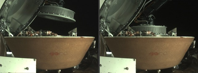 The left image shows the OSIRIS-REx collector head hovering over the Sample Return Capsule (SRC) after the Touch-And-Go Sample Acquisition Mechanism arm moved it into the proper position for capture. The right image shows the collector head secured onto the capture ring in the SRC. Both images were captured by the StowCam camera.