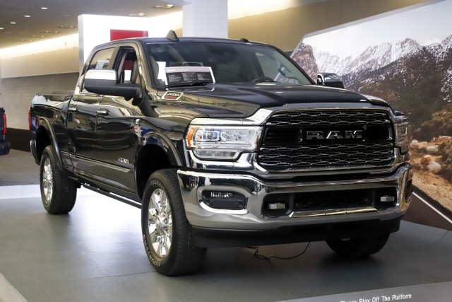 FILE - In this Feb. 14, 2019, photo a Ram 2500 Limited truck on display at the 2019 Pittsburgh International Auto Show in Pittsburgh. Fiat Chrysler's Ram pickup unseated General Motors' Chevrolet Silverado as the second-best selling vehicle in the U.S. during the first nine months of the year. (AP Photo/Gene J. Puskar, File)
