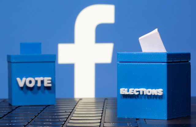 3D printed ballot boxes are seen in front of a displayed Facebook logo in this illustration taken November 4, 2020. REUTERS/Dado Ruvic/Illustration