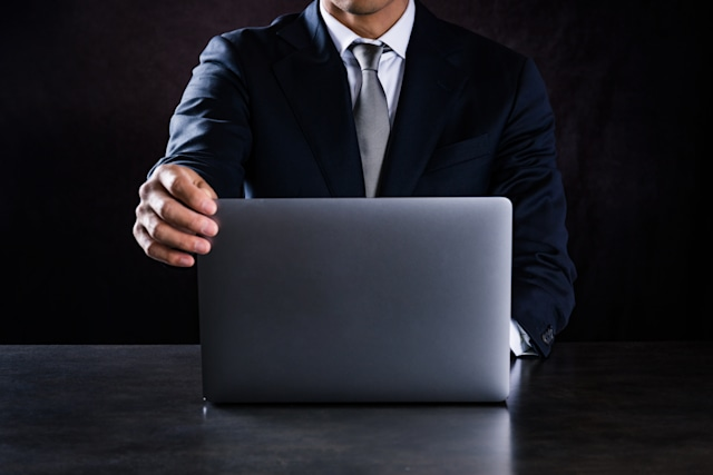 This is a photograph of businessman using laptop computer