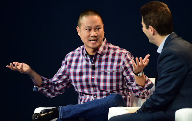 Tony Hsieh, CEO of Zappos, responds to questions from interviewer Dennis Berman at  2015 WSJD Live on October 20, 2015 in Laguna Beach, California. WSJ D Live brings together top CEOs, founders, pioneers, investors and luminaries to explore the most exciting tech opportunities emerging around the world. AFP PHOTO / FREDERIC J. BROWN        (Photo credit should read FREDERIC J. BROWN/AFP via Getty Images)