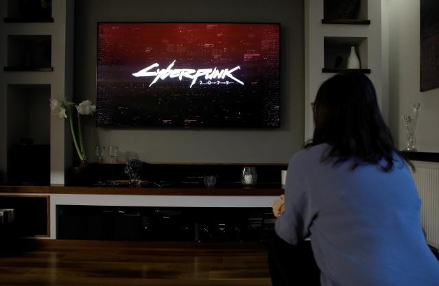 Karolina Kaluzynska, 28, plays CD Projekt's game Cyberpunk 2077 in Warsaw, Poland, December 14, 2020. REUTERS/Kacper Pempel