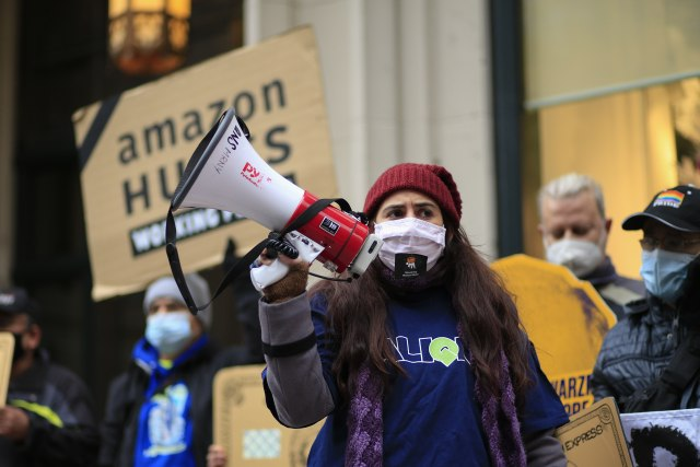 Maritza Silva, executive director of Align NY, speaks during a protest organized by New York Communities for Change and Make the Road New York in front of the Jeff Bezos' Manhattan residence in New York on December 2, 2020. (Photo by Kena Betancur / AFP) (Photo by KENA BETANCUR/AFP via Getty Images)