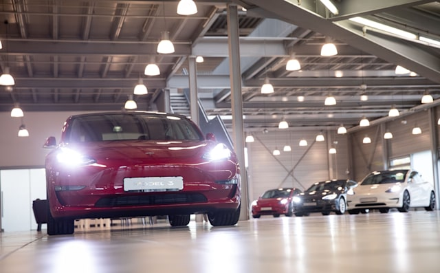 21 October 2020, Hamburg: A Tesla Model 3 (l) and other Tesla models are on display in the new Tesla Service Center. Photo: Christian Charisius/dpa (Photo by Christian Charisius/picture alliance via Getty Images)