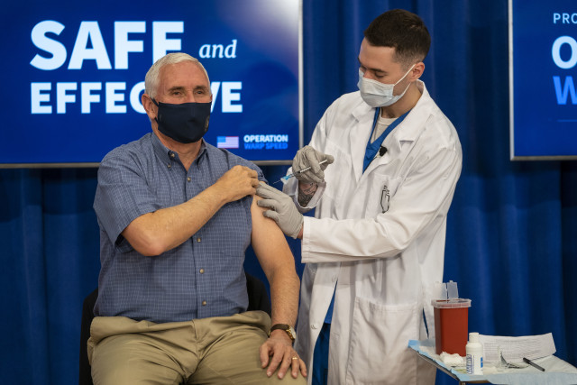 WASHINGTON, DC - DECEMBER 18: U.S. Vice President Mike Pence receives a COVID-19 vaccine to promote the safety and efficacy of the vaccine at the White House on December, 18, 2020 in Washington, DC.  (Photo by Doug Mills-Pool/Getty Images)