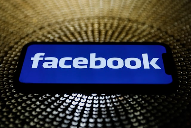 Facebook logo is seen displayed on a phone screen in this illustration photo taken on October 3, 2020. (Photo by Jakub Porzycki/NurPhoto via Getty Images)