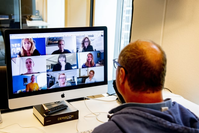 THE HAGUE, NETHERLANDS - 2020/06/12: A director is seen having an online meeting with his employees through a laptop on zoom video call app. The Dutch government has ordered all offices to be closed until further notice in attempt to control the spread of the COVID-19 Coronavirus. (Photo by Robin Utrecht/SOPA Images/LightRocket via Getty Images)