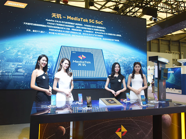 SHANGHAI, CHINA - OCTOBER 14, 2020 - Models stand for Mediatek 5G Breguet chip at the China International Semiconductor Expo 2020. Shanghai, China, October 14, 2020.- PHOTOGRAPH BY Costfoto / Barcroft Studios / Future Publishing (Photo credit should read Costfoto/Barcroft Media via Getty Images)