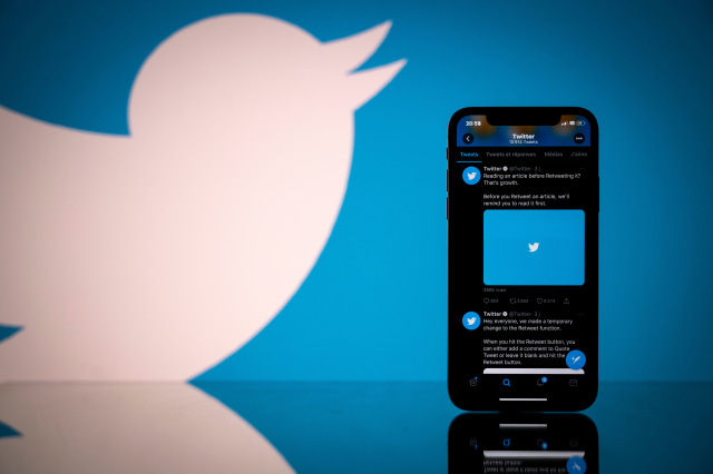This photograph taken on October 26, 2020 shows the logo of US social network Twitter displayed on the screen of a smartphone and a tablet in Toulouse, southern France. (Photo by Lionel BONAVENTURE / AFP) (Photo by LIONEL BONAVENTURE/AFP via Getty Images)