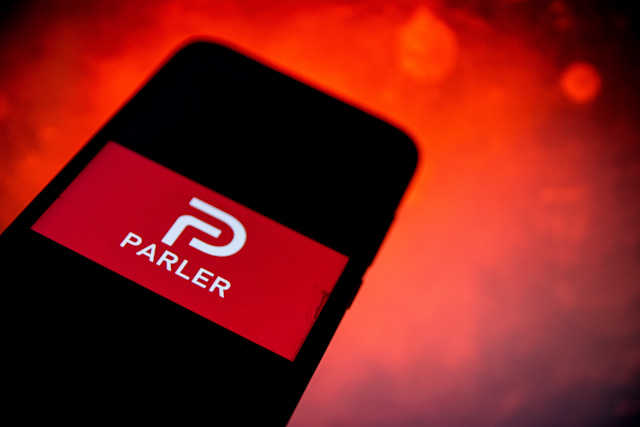 In this photo illustration Parler logo are displayed on a smartphone screen in Athens, Greece on January 12, 2020. (Photo by Nikolas Kokovlis/NurPhoto via Getty Images)