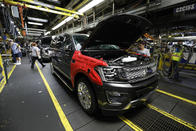LOUISVILLE, KY - OCTOBER 27:  A worker builds the all-new 2018 Ford Expedition SUV as it goes through the assembly line at the Ford Kentucky Truck Plant October 27, 2017 in Louisville, Kentucky. Ford recently invested $900 million in the plant for upgrades to build the all-new Expedition and Lincoln Navigator, securing 1000 hourly U.S. jobs. (Photo by Bill Pugliano/Getty Images)