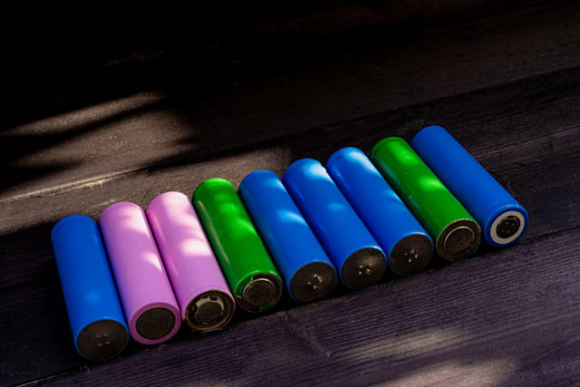 Batteries in '18650' format, on wooden background