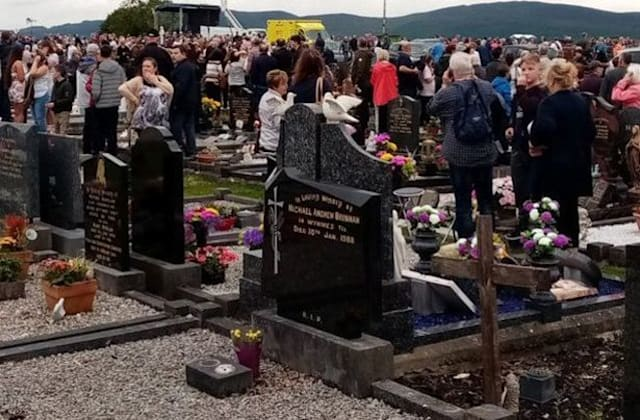 Car ploughs into crowd at cemetery