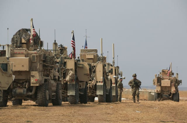 American troops heckled, pelted amid Syria pullout