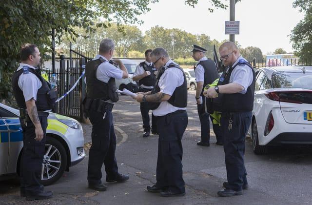 Revellers sit on suspected killer