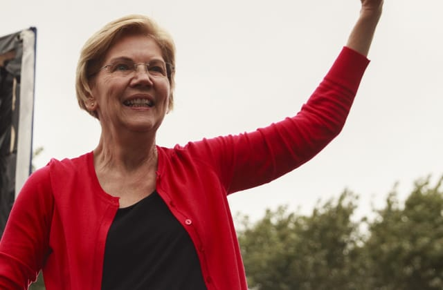 Warren surges in Iowa, tops Biden in predictive poll