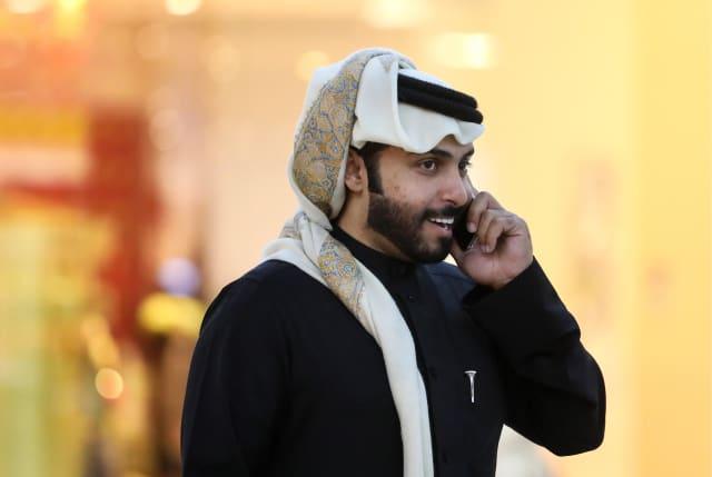 DOHA, QATAR - DECEMBER 11, 2017: A Muslim man talks on the phone at Villaggio Mall. Valery Sharifulin/TASS (Photo by Valery SharifulinTASS via Getty Images)