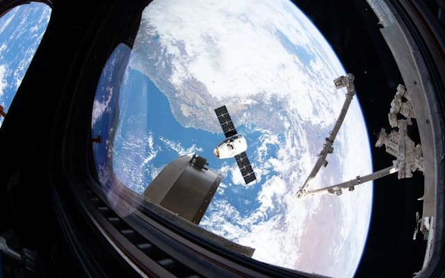 A SpaceX Dragon resupply ship slowly approaches the ISS on Dec. 9, 2019.