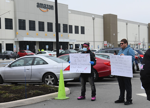 Amazon workers at Amazon's Staten Island warehouse strike in demand that the facility be shut down and cleaned after one staffer tested positive for the coronavirus on March 30, 2020 in New York. - Amazon employees at a New York City warehouse walk off the job March 30, 2020, as a growing number of delivery and warehouse workers demand better pay and protections in the midst of the COVID-19 pandemic. (Photo by Angela Weiss / AFP) (Photo by ANGELA WEISS/AFP via Getty Images)