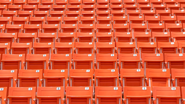 Stadium seat rows in sports arena for football or soccer game, public theatre, concert hall amphitheater with empty red audience chair for outdoor sporty recreational background