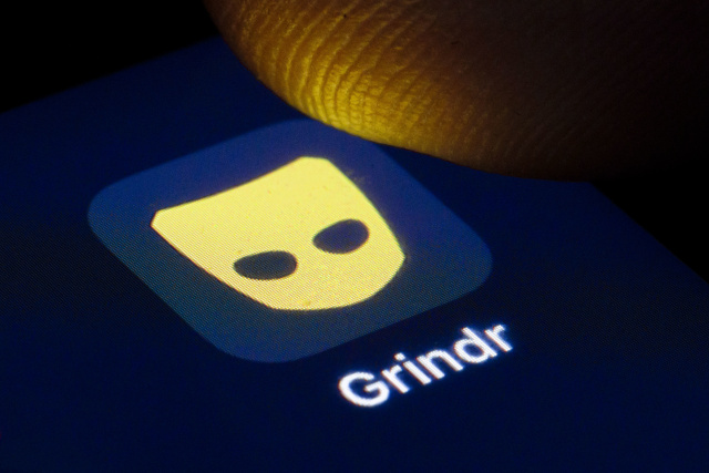 BERLIN, GERMANY - APRIL 22: The logo of the dating app for gay and bisexual men Grindr is shown on the display of a smartphone on April 22, 2020 in Berlin, Germany. (Photo by Thomas Trutschel/Photothek via Getty Images)