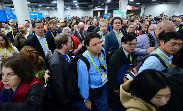 A crowd makes their way through the showroom floor at the 2017 Consumer Electronics Show in Las Vegas, Nevada, on January 5, 2017.  / AFP / Frederic J. BROWN        (Photo credit should read FREDERIC J. BROWN/AFP via Getty Images)