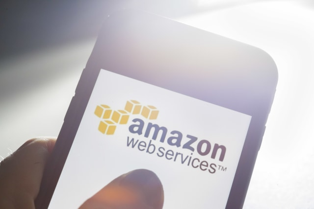 Berlin, Germany - July 09: In this photo illustration the Logo of Amazon Web Services ( AWS ) is displayed on a smartphone on July 09, 2019 in Berlin, Germany. (Photo by Thomas Trutschel/Photothek via Getty Images)
