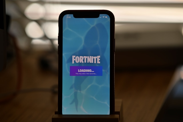This illustration picture shows Epic Games' Fortnite loading on a smartphone in Los Angeles on August 14, 2020. - Apple and Google on August 13, 2020 pulled video game sensation Fortnite from their mobile app shops after its maker Epic Games released an update that dodges revenue sharing with the tech giants. (Photo by Chris DELMAS / AFP) (Photo by CHRIS DELMAS/AFP via Getty Images)