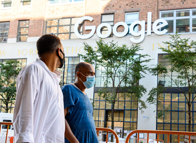 NEW YORK, NEW YORK - JULY 31: People wear protective face masks outside the Google offices in Chelsea as the city continues Phase 4 of re-opening following restrictions imposed to slow the spread of coronavirus on July 31, 2020 in New York City. The fourth phase allows outdoor arts and entertainment, sporting events without fans and media production. (Photo by Noam Galai/Getty Images)