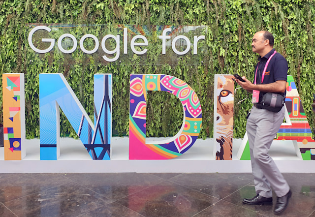 """A man walks past the sign of """"Google for India"""", the company's annual technology event in New Delhi, India, September 19, 2019. REUTERS/Sankalp Phartiyal"""