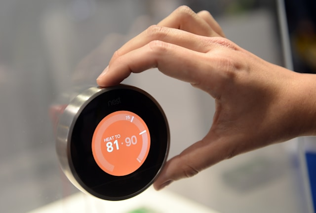 A thermostat from 'Nest' at CES (Consumer Electronics Show) in Las Vegas, Nevada, USA, 08 January 2015. The trade show takes place from 06 to 09 January 2015. Photo: BRITTA PEDERSEN/dpa | usage worldwide   (Photo by Britta Pedersen/picture alliance via Getty Images)