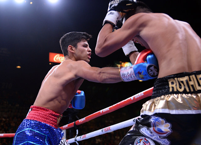 Nov 2, 2019; Las Vegas, NV, USA; Ryan Garcia (blue trunks) and Romero Duno (black trunks) box during their WBC silver and NABO lightweight title bout at MGM Grand Garden Arena. Garcia won via first round TKO. Mandatory Credit: Joe Camporeale-USA TODAY Sports