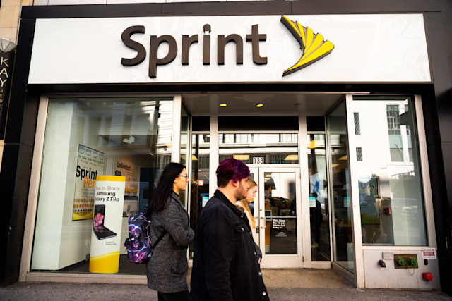 NEW YORK CITY, UNITED STATES - 2020/02/20: Pedestrians walk past an American telecommunications company Sprint store in New York City. (Photo Illustration by Alex Tai/SOPA Images/LightRocket via Getty Images)