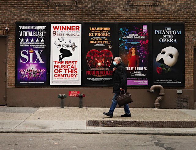 NEW YORK, NEW YORK - JANUARY 15: A person walks by Broadway posters near Times Square as theaters remain closed following restrictions imposed to slow the spread of coronavirus on January 15, 2021 in New York City. The pandemic has caused long-term repercussions throughout the tourism and entertainment industries, including temporary and permanent closures of historic and iconic venues, costing the city and businesses billions in revenue. (Photo by Cindy Ord/Getty Images)