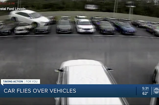 Out-of-control vehicle caught on camera flying into car dealership