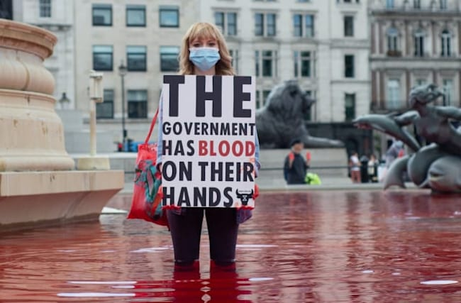Arrests after protesters dye Trafalgar Square fountains red