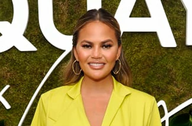 Chrissy Teigen Roasts Fan Who Told Her To Put On A Bra