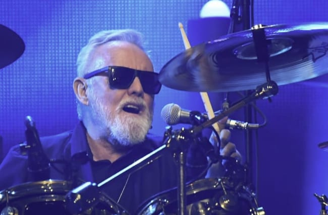 Queen's Roger Taylor sports scuba mask during gig