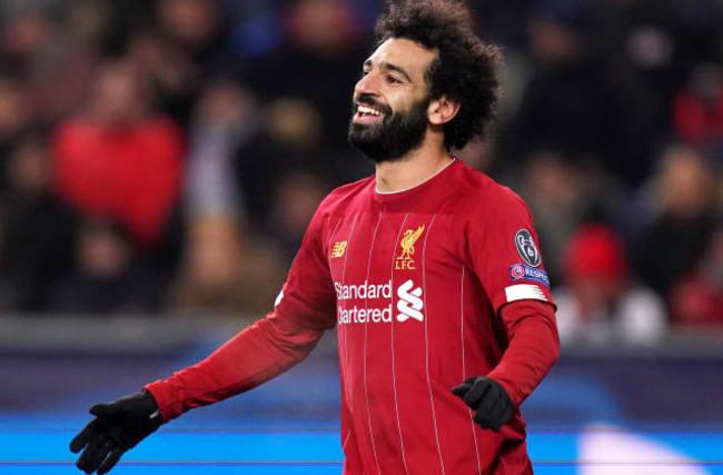 Salah strikes to help Liverpool reach Champions League last 16
