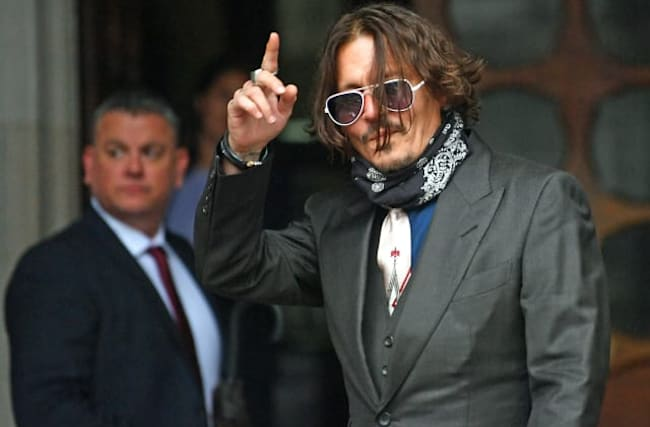 Depp denies slapping ex-wife over 'Wino Forever' tattoo