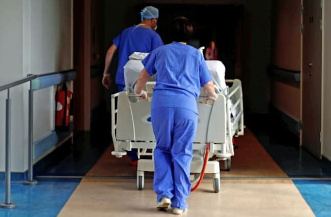 Total UK deaths involving Covid-19 pass 50,000 mark